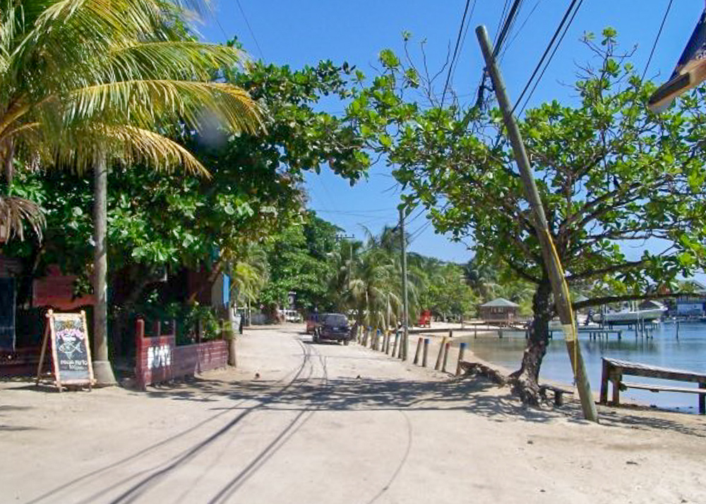 sandy main street in West Bay Roatan, Honduras