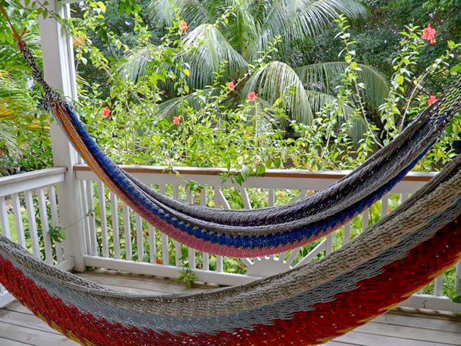 double hammocks on a balcony at Henry Morgan Courtyard grounds in West Bay in Roatan, Honduras