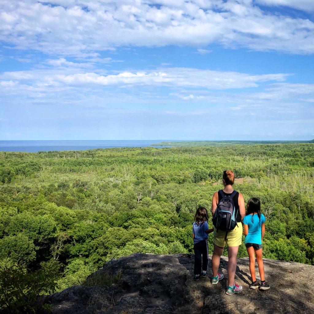 My and my kids on Skinner's Bluff look out #brucetrail #skinnersbluff #wiartonontario #epichikes #hikewithkids #takeyourkidseverywhere
