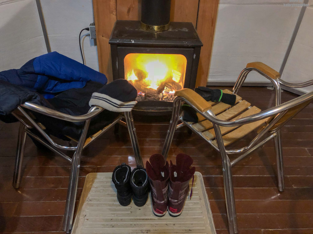 Inside yurt #60, keeping boats and socks and mitts dry and warm while winter camping at MacGregor Point Provincial Park in February #findyourselfhere #macgregorpointprovincialpark #macgregorpoint #macgregorpp #ontarioparks #yurtcamping #wintercamping #outdoors #adventureparenting #portelgin #brucepeninsula