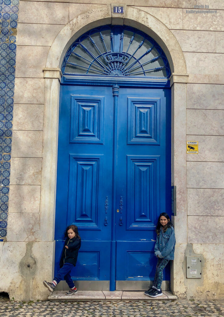 The doors of Lisbon, Barcelona and Paris. This beautiful, blue door my kids are posing in front of is from in the Bairro Alto district in the city of Lisbon