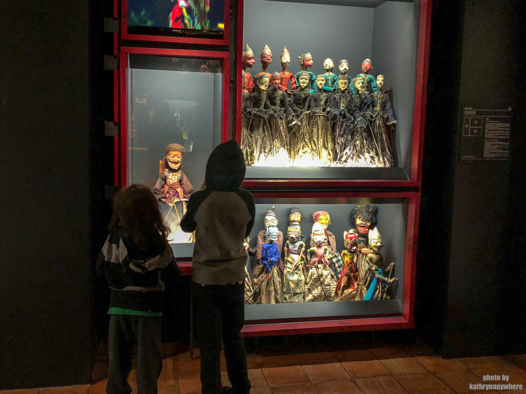 My kids checking out a display in Museum of the Marionette, The Marionette Museum In Lisbon, The Puppet Museum, Museu da Marioneta, Lisbon Portugal, Lisboa