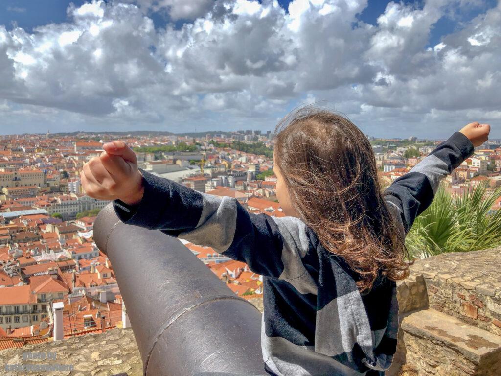 Little Man riding a canon at Castelo Sao Jorge in Lisbon, Portugal