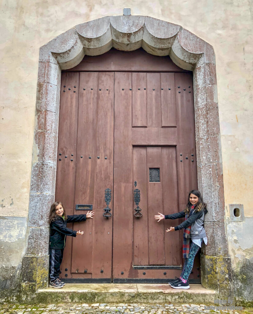 The doors of Lisbon, Barcelona and Paris. This door my kids are posing in front of is from the town of Sintra, close to Pena Palace in the Lisboa province.