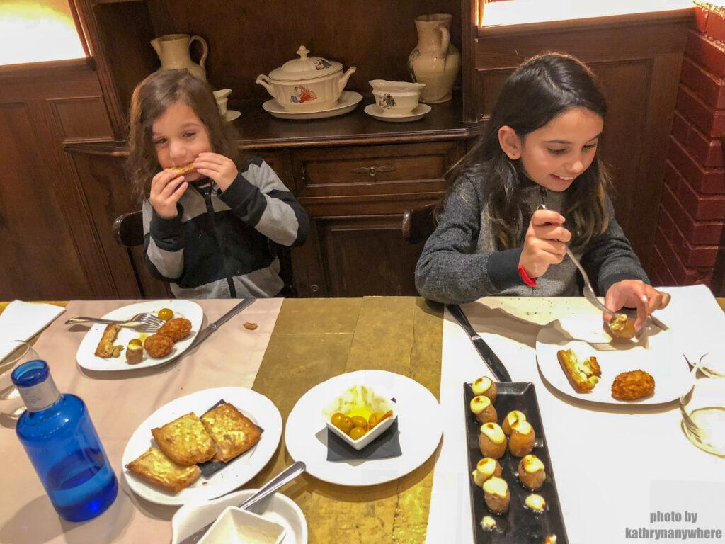 kids eating tapas in barcelona, spain
