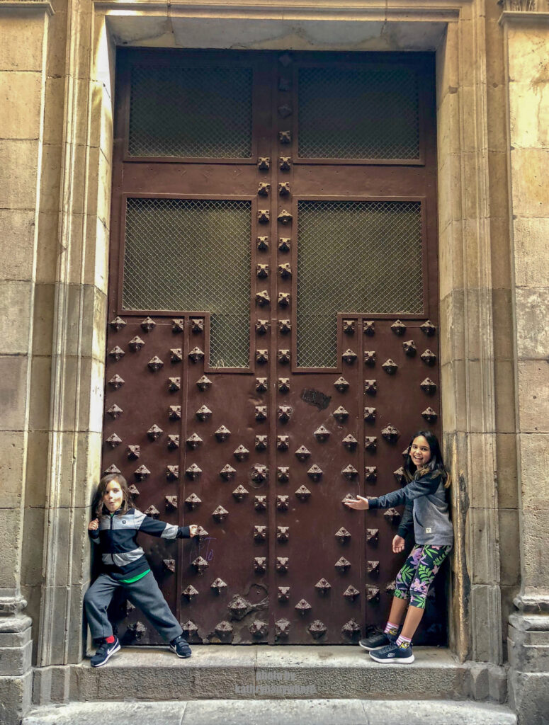 The doors of Lisbon, Barcelona and Paris. This dungeon like brown door my kids are posing in front of, was in one of the pedestrian alleys in the gothic quarter of Barcelona.