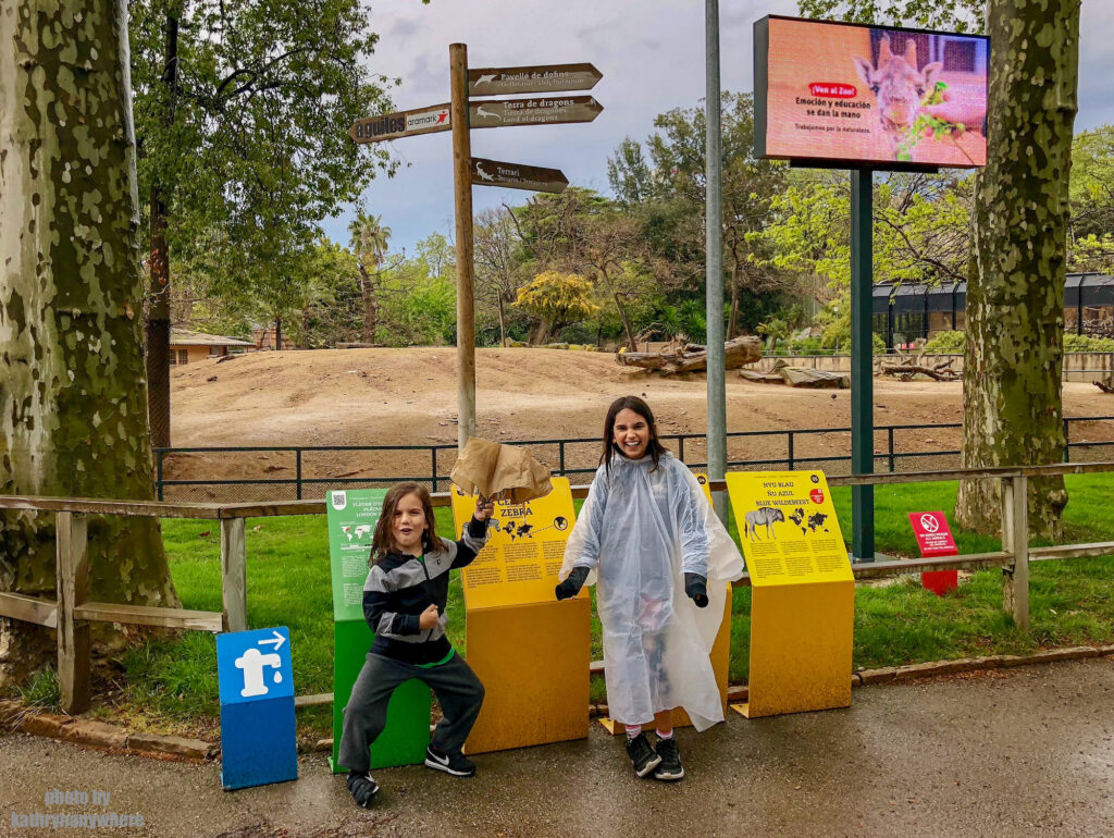 extremely happy kids having a great day at the Barcelona Zoo. Even though it rained, I had to make them happy somehow.