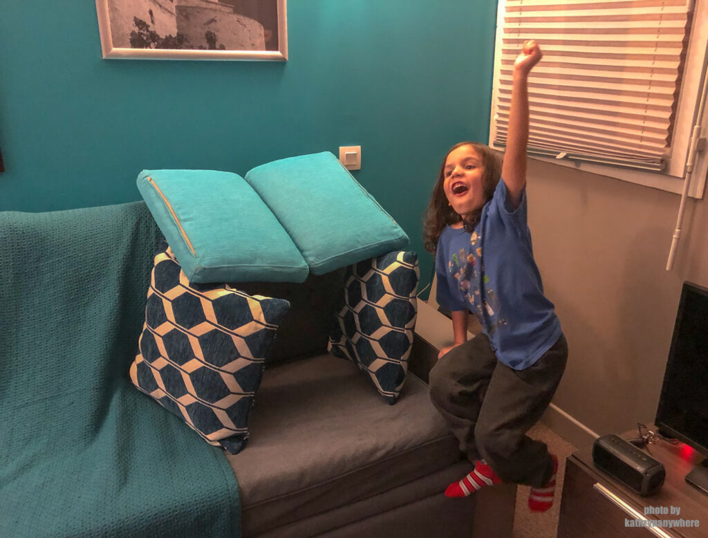 my son making a fort in out 1 bedroom apartment of our accommodations in Marseille, France