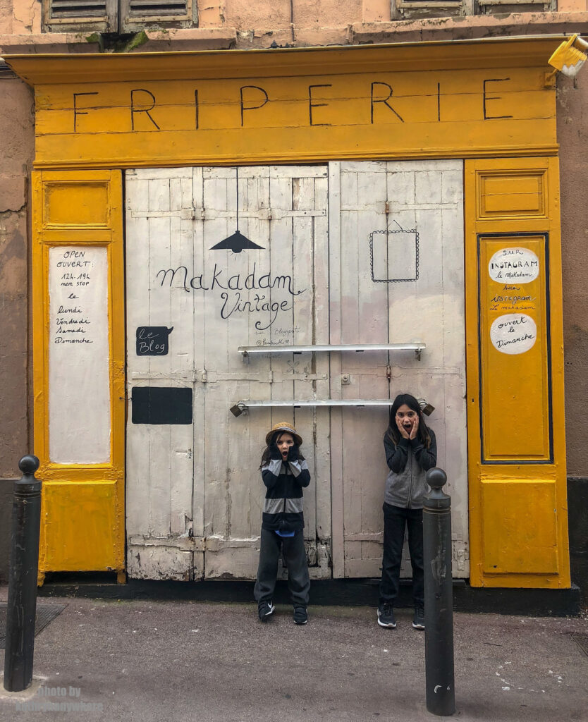 The doors of Lisbon, Barcelona and Paris. This door my kids are posing in front of in Marseille on Rue Vacon, in front of Le Makadam, which appears to be a vintage store. We were too early to find out for sure.
