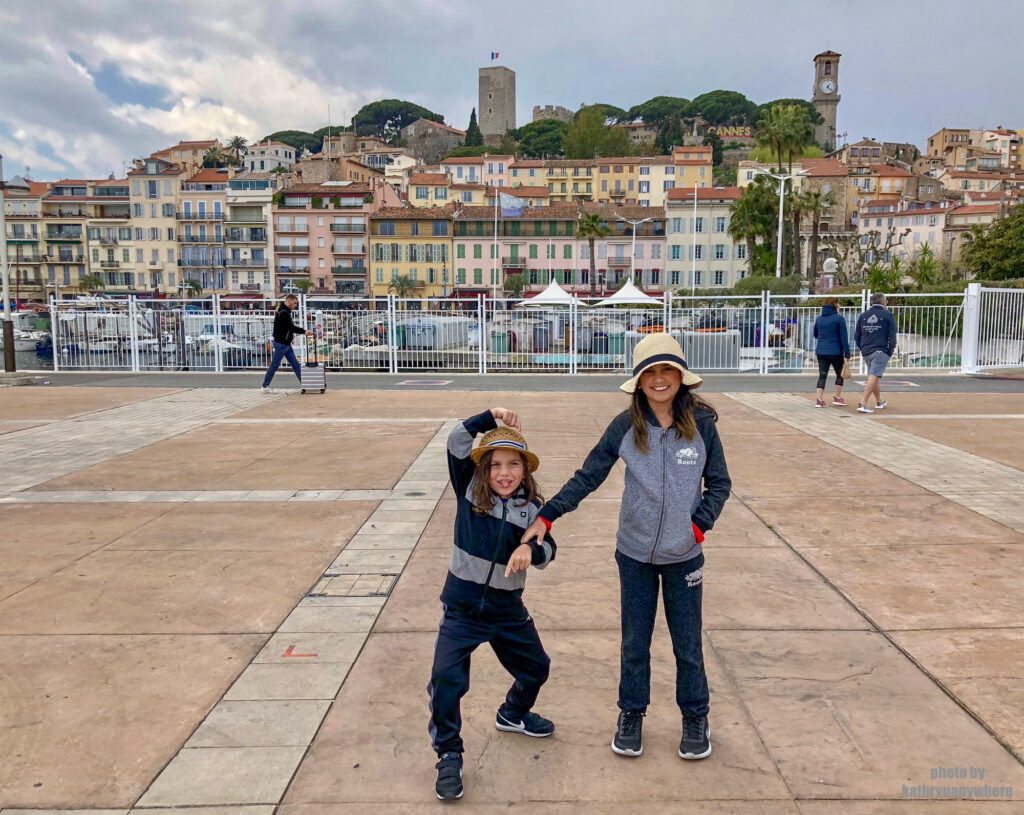 Le Suquet, one of the oldest neighbourhoods in Cannes behind my kids in the south of France