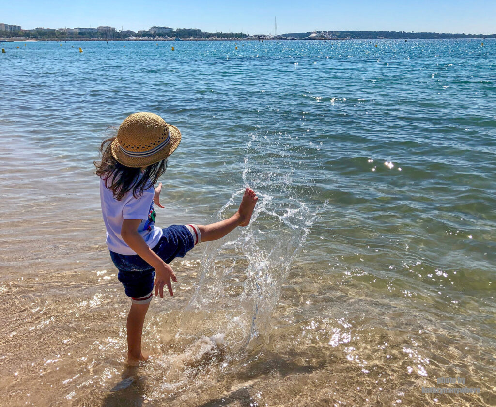 my son wading in the water in the Bay of Cannes, south of France