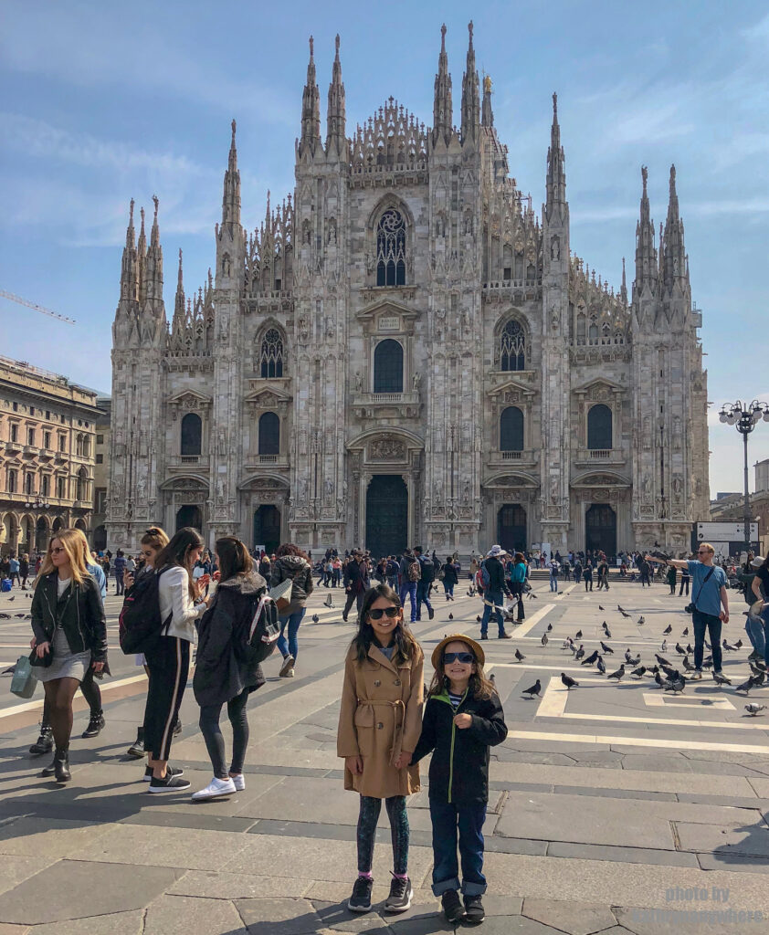 Miss M and Little Man in front of the duomo in milan, italy