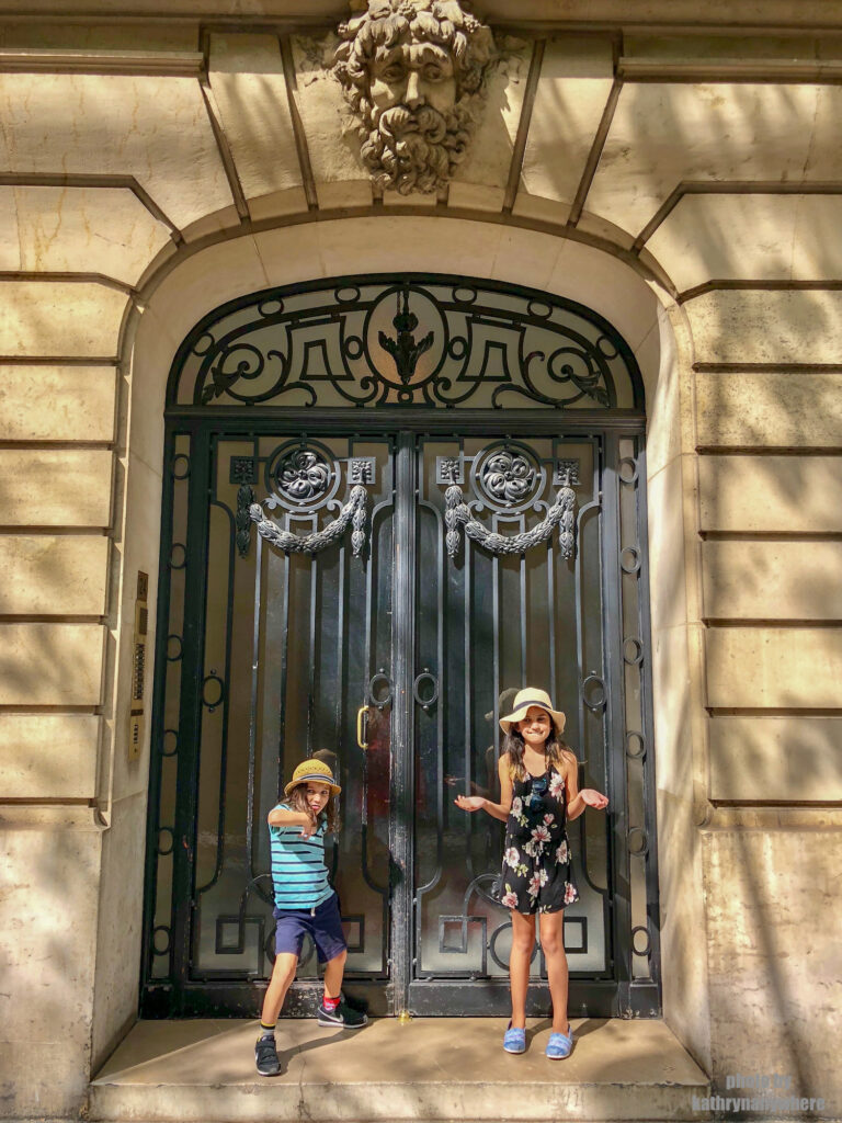 This glass door picture with my children was taken in 7th arrondissement neighbourhood in Paris, France