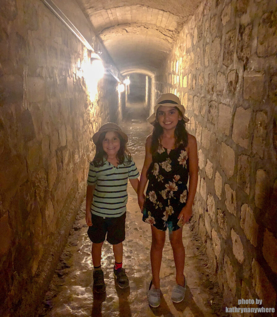 The kids in the tunnel of the catacombs of Paris.