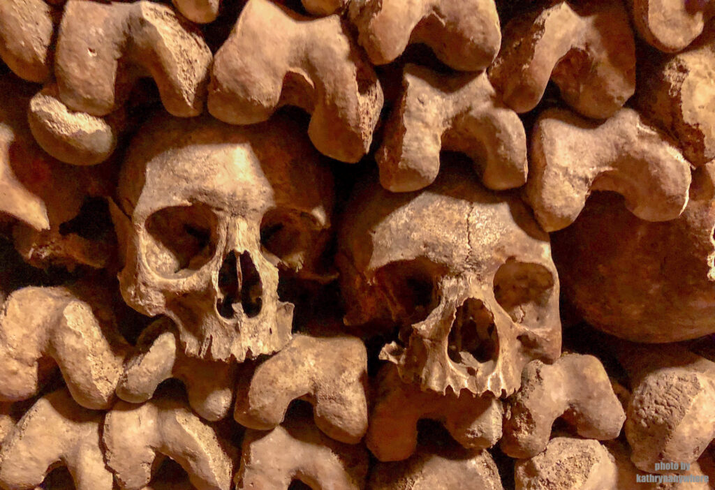 Skulls in the Catacombs of Paris. This ossuary was created as part of the effort to eliminate the city's overflowing cemeteries