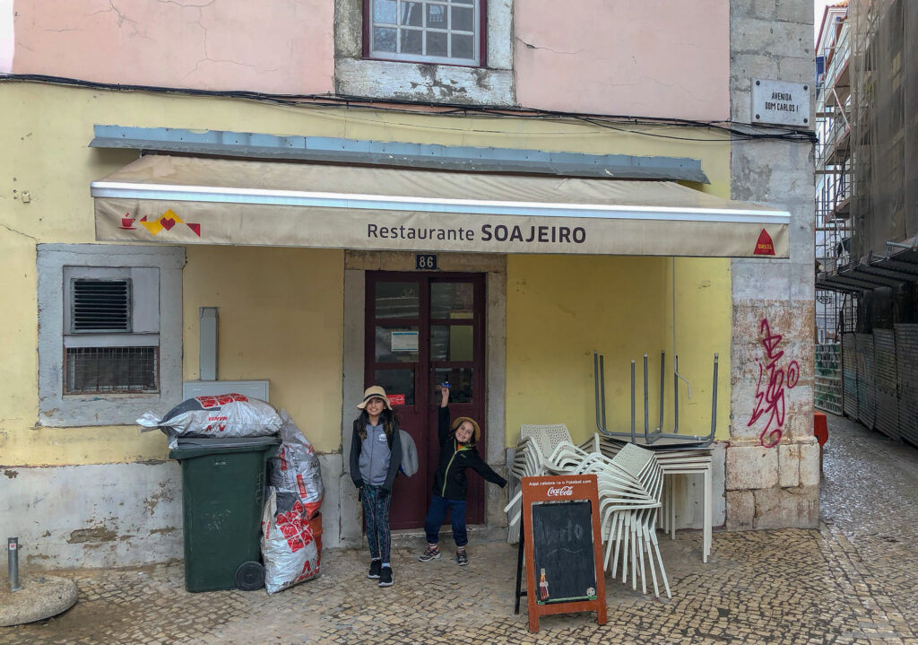 Restaurante SoaJeiro in Lisbon, Portugal exterior with my kids posing in front of it