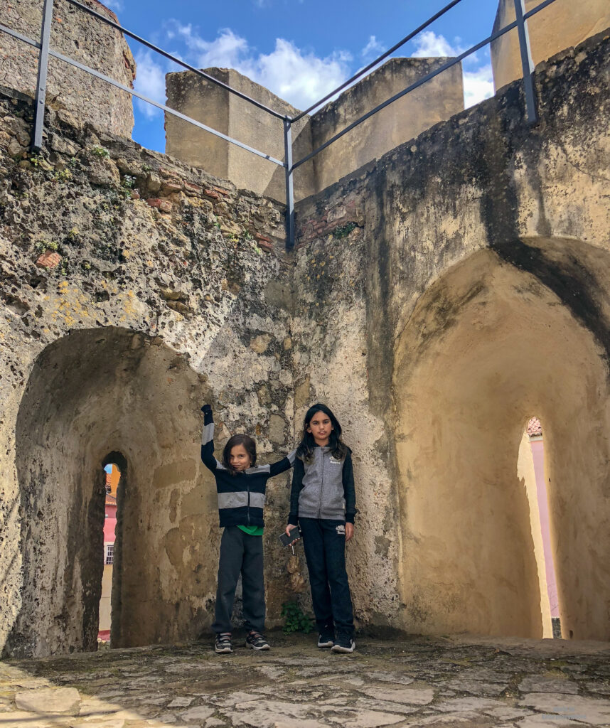 inside the grounds of Castelo Sao Jorge with Miss M and Little Man