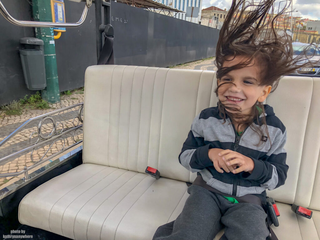 Little Man enjoying his tuk tuk ride to the district of Belem in Lisbon, Portugal