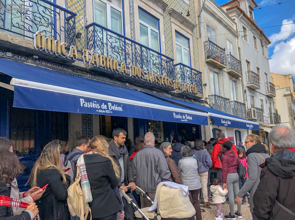 The outside line up madness of Pastéis de Belém in Lisbon, Portugal. This was an added stop in our Lisbon itinerary