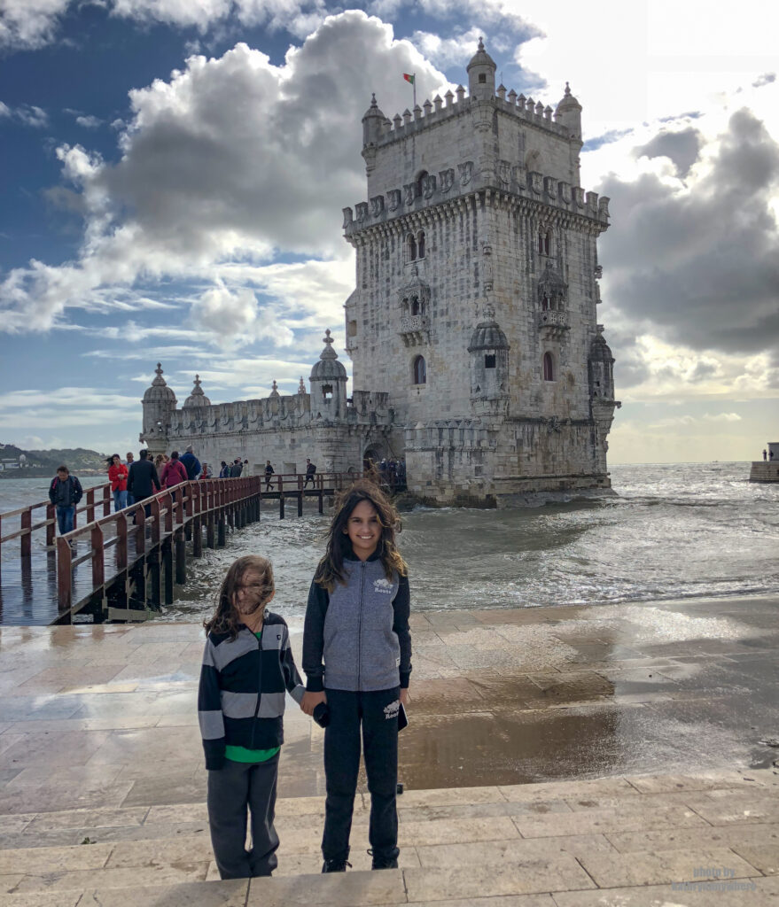 The kids outside the tower of Belem in Lisbon, Portugal. Belém Tower is a UNESCO World Heritage Site played a key role in Europe's Age of Discoveries, since it served both as a fortress and as a port from where Portuguese explorers departed to establish what would be the first European trade in history with China and India.