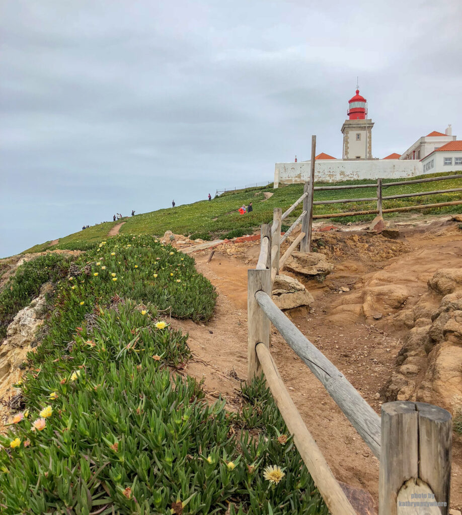 The Cabo da Roca Lighthouse is a beacon/lighthouse located 165 metres above the Atlantic Ocean, on Portugal's most westerly extent. It is located in the civil parish of Colares, in the municipality of Sintra, situated on a promontory that juts out into the ocean, made up of granite boulders and interspersed limestone.