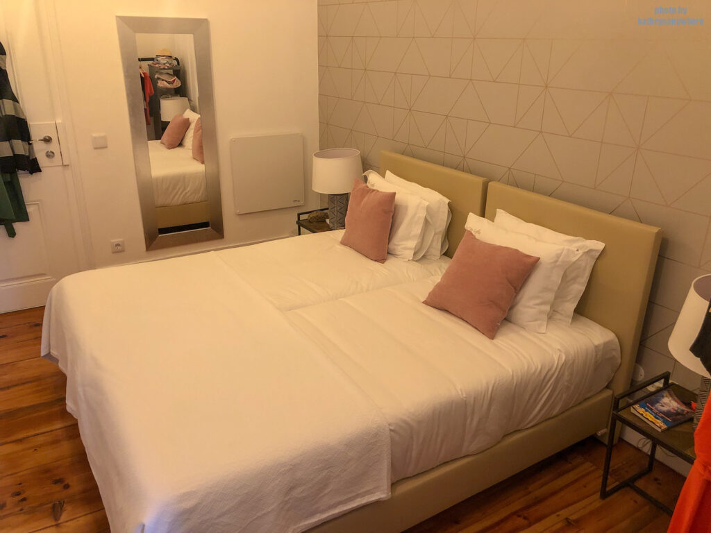 two twin beds in the triple room at City Lofts Guesthouse in Lisbon, Portugal