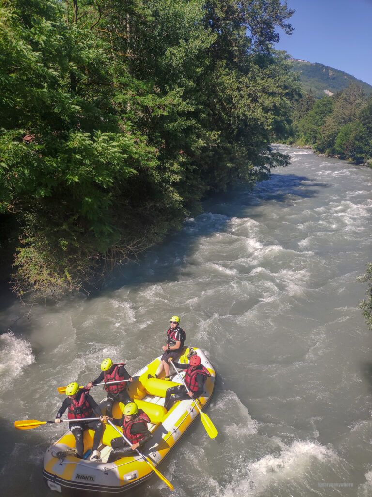 Our raft sailing down the river. Good times on the Isere River in the French Alps.