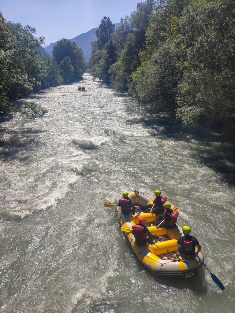 Two rafts on the Isere River water water rafting. We are the boat in the back.