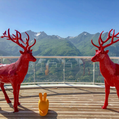 The iconic red caribou on the terrace at the Belevedre Collection at Club Med Les Arcs Panorama