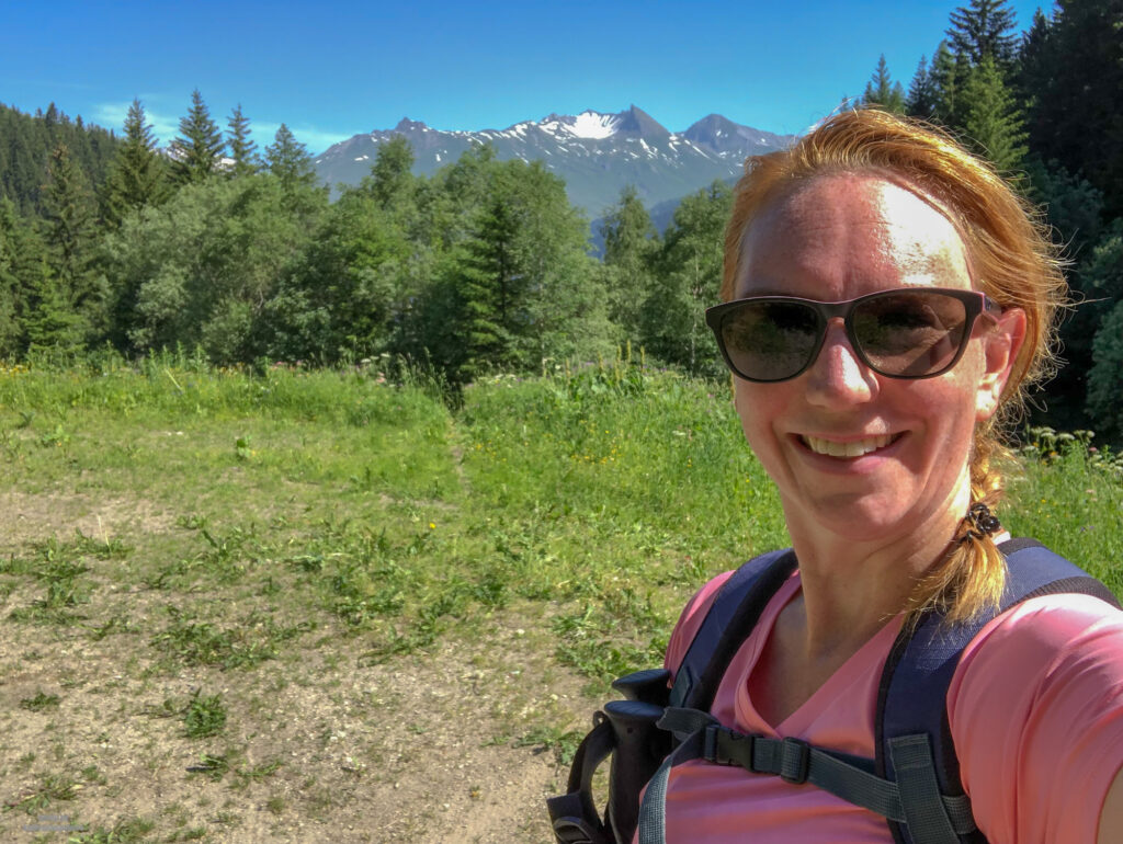 Red faced selfie hiking the red level hike in the French Alps. More adventure self care.