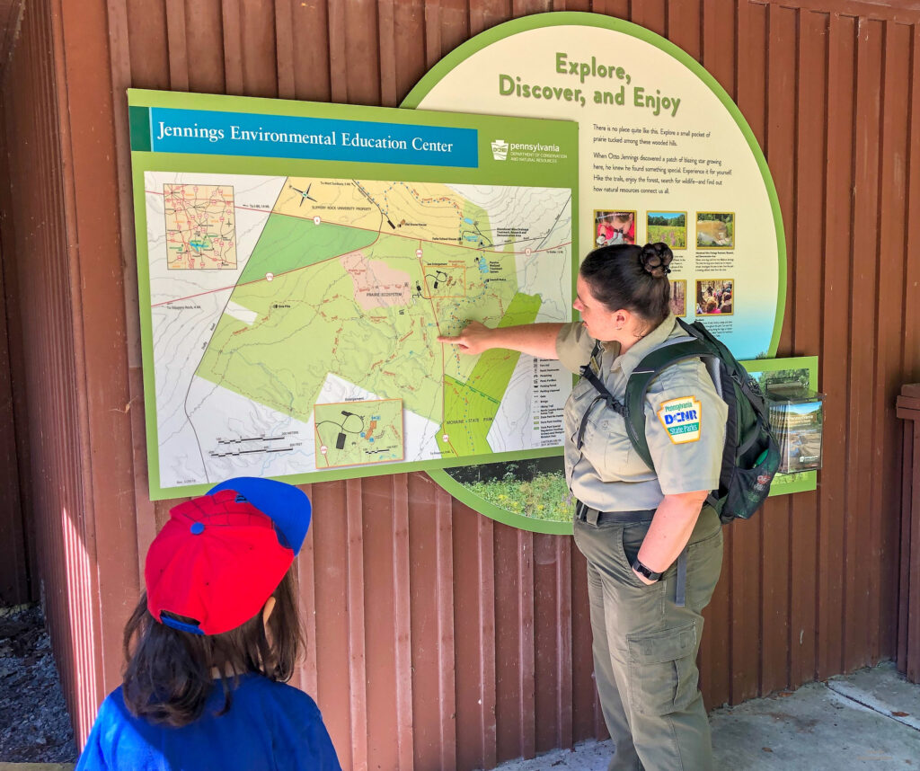 Looking at the hiking trail map outside the visitor's center of Jennings Educational Centre in Slippery Rock, PA