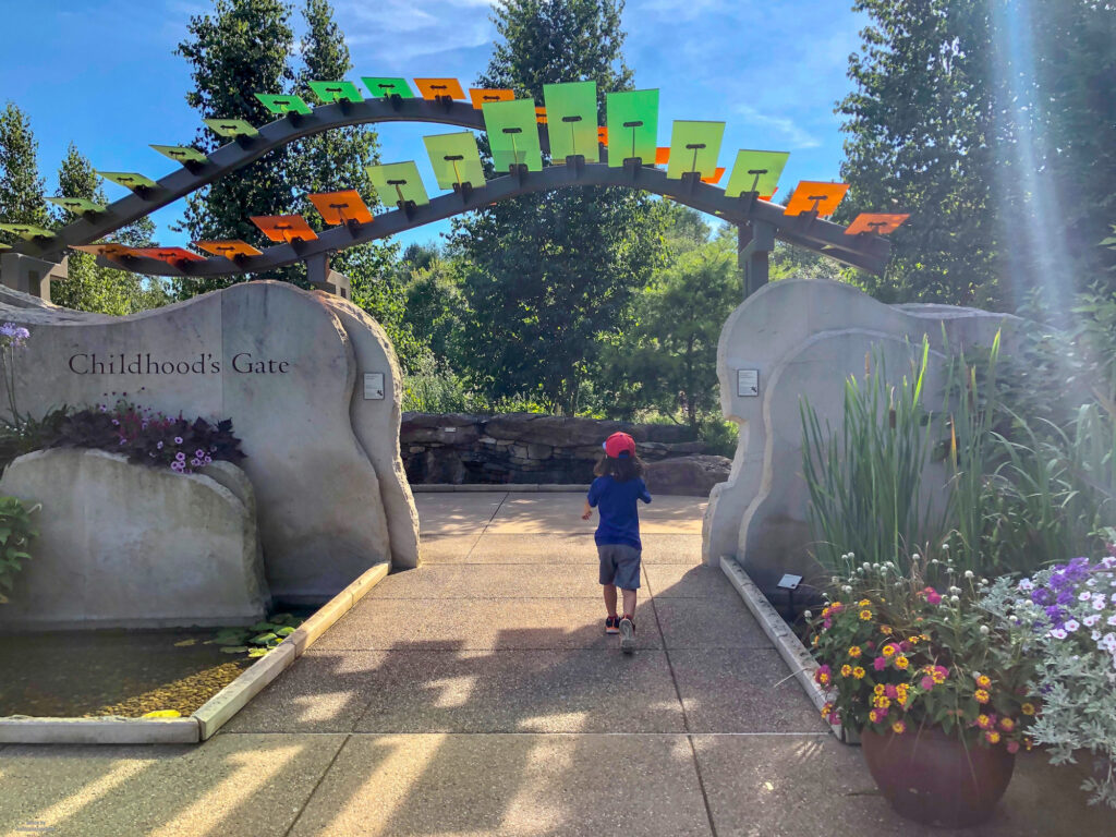 Little Man running through the Childhood's Gate at the Penn State Arboretum