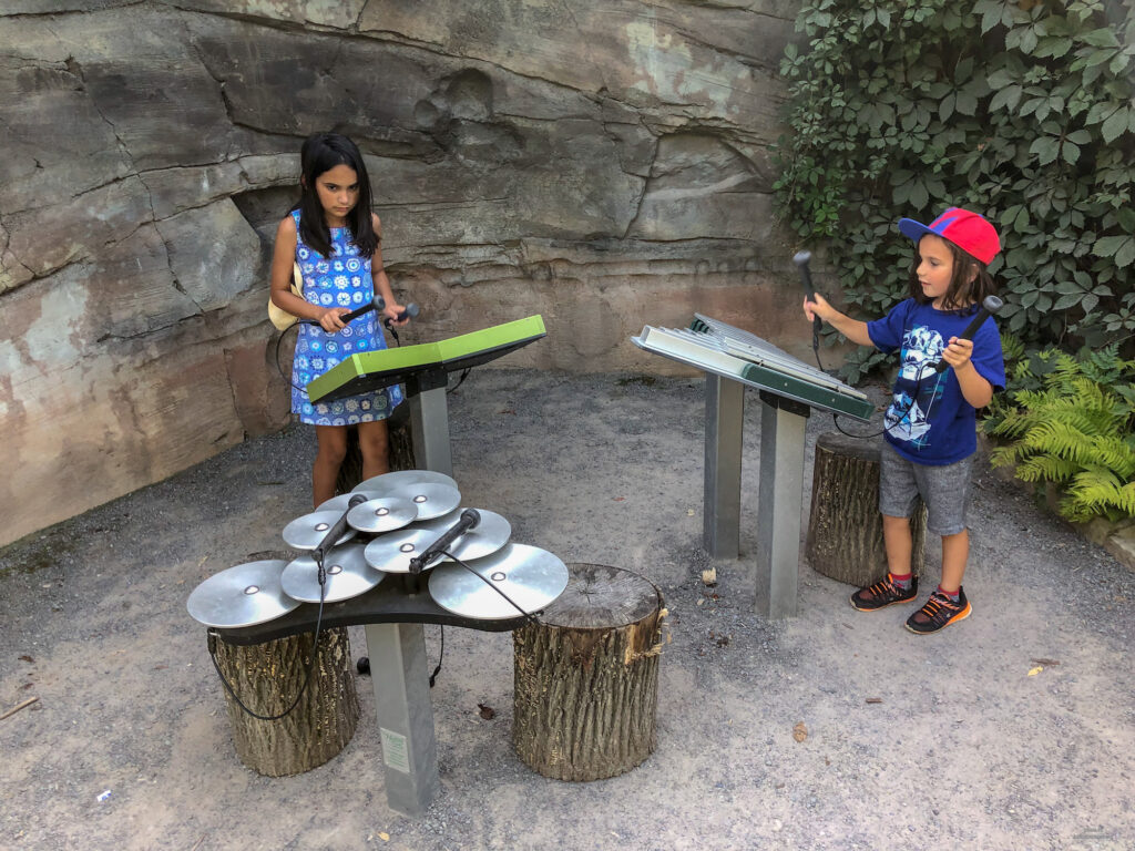 Exploring musical instruments and sounds in the children's garden at the arboretum at Penn State