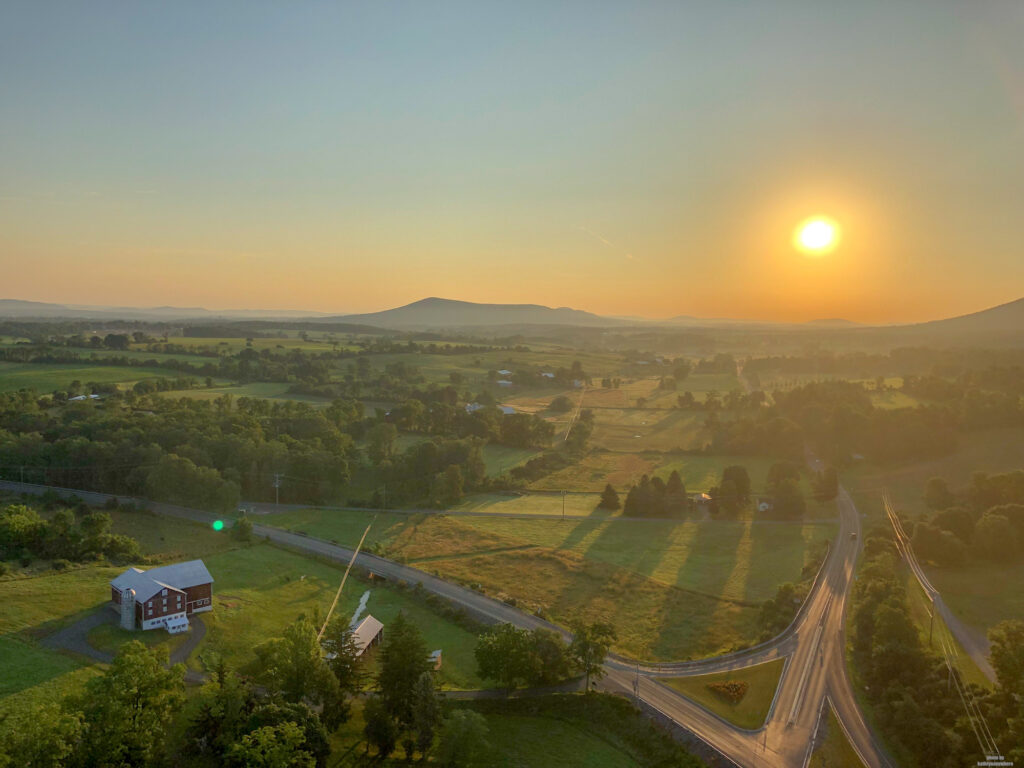 The sunrise view of the countryside just outside of State College, PA from a hot air balloon.