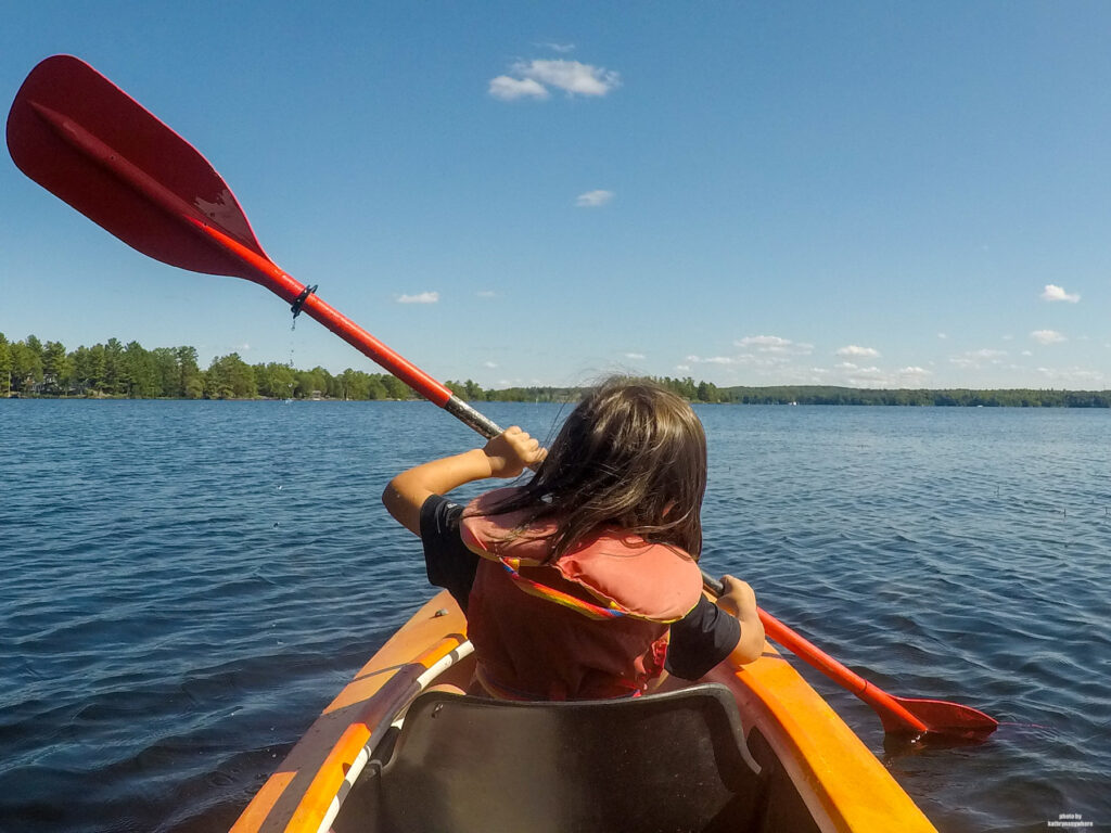My son learning how to kayak on Stoney Lake