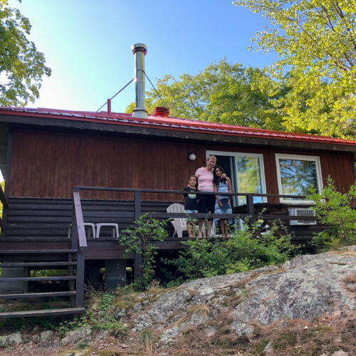 My mom and children on a deck of our 2 bedroom cottage at Viamede Resort