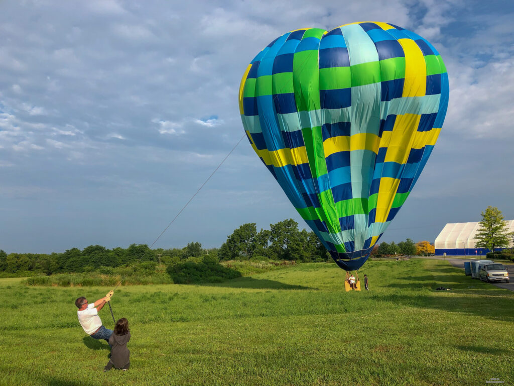 End of the hot air balloon ride. Little Man assisting with pulling down the balloon