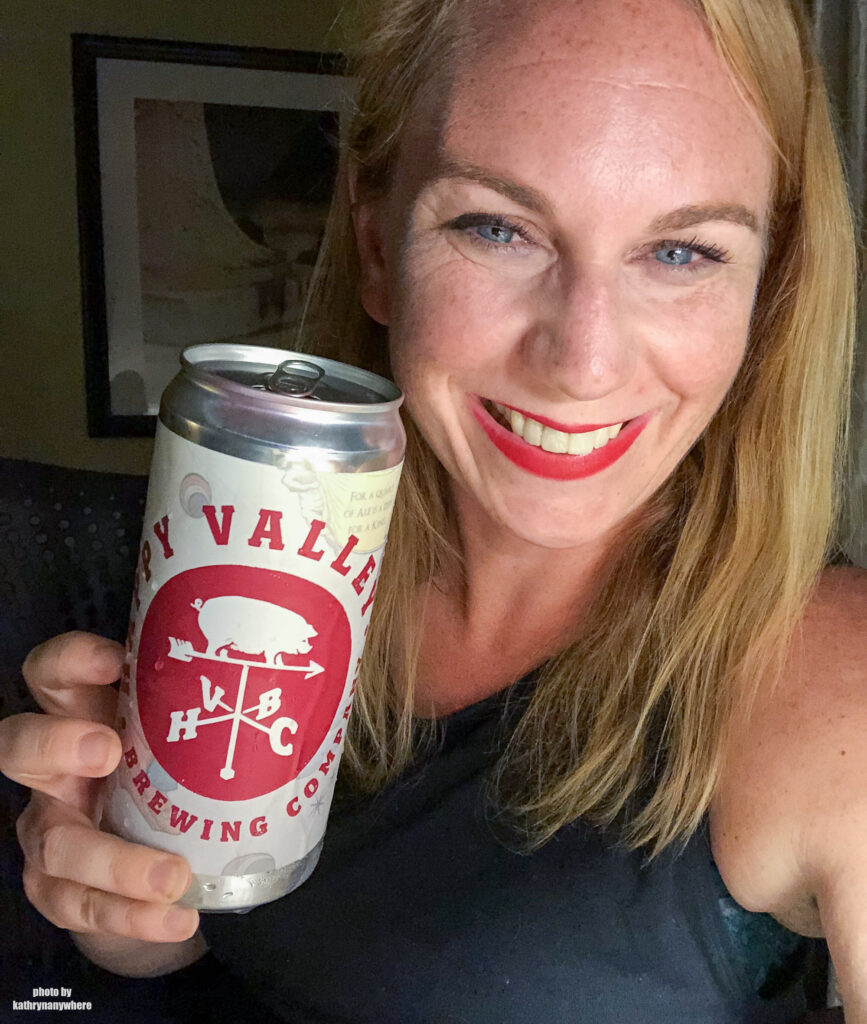 A summer session springtail ale in a tall can from Happy Valley Brewing Company with a tanned and happy me