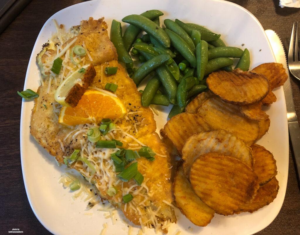 fish dinner at exterior of Edgewater Inn & Riverside Grille