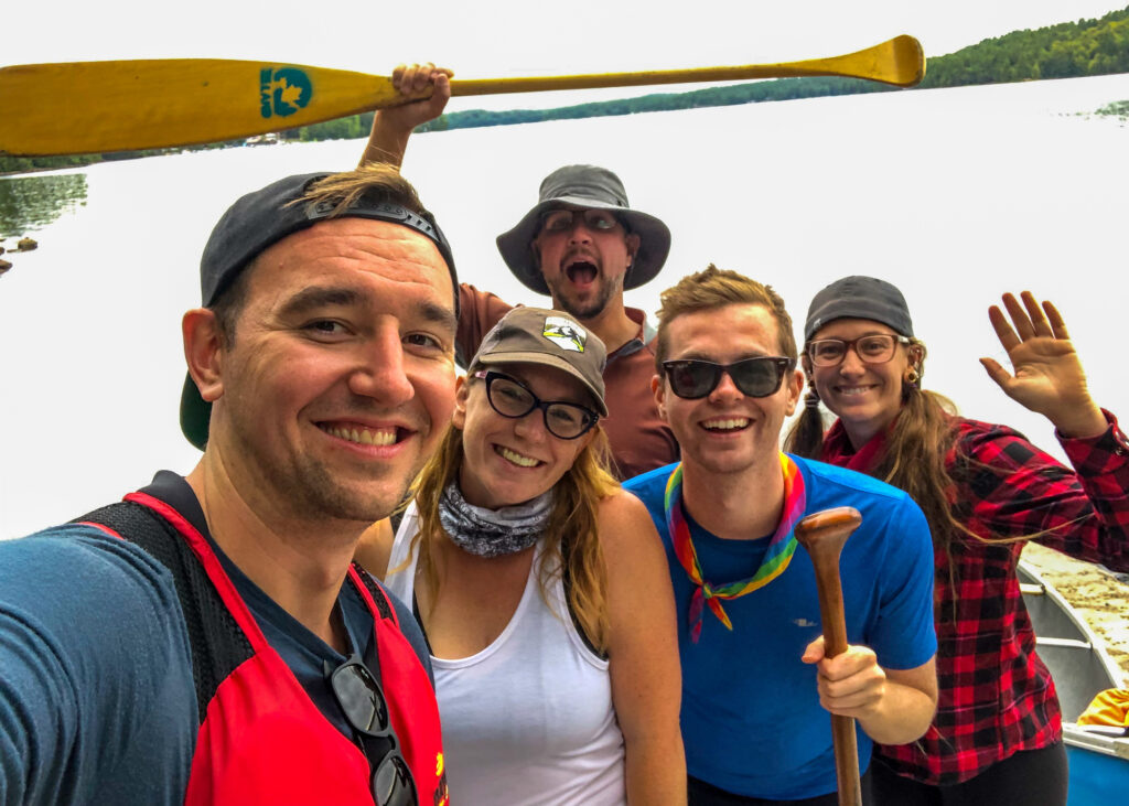 End of canoe portage selfie of Chris, Kat, Kevin, Ryan and Kim. Photo by Chris Mitchell of Traveling Mitch.