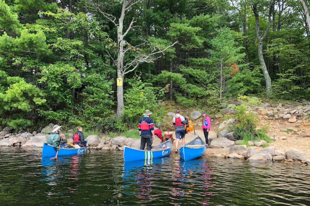 Unloading our first portage and from Anstruther Lake to Rathbun Lake