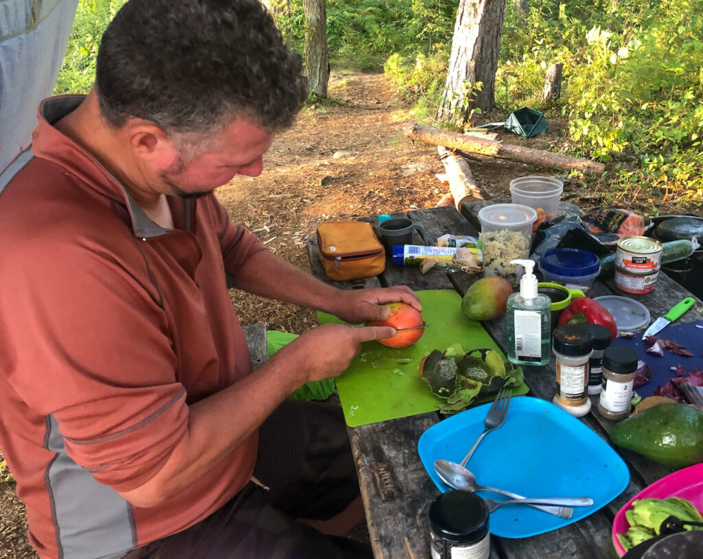 Kevin from Wandering Wagars preparing lunch while camping