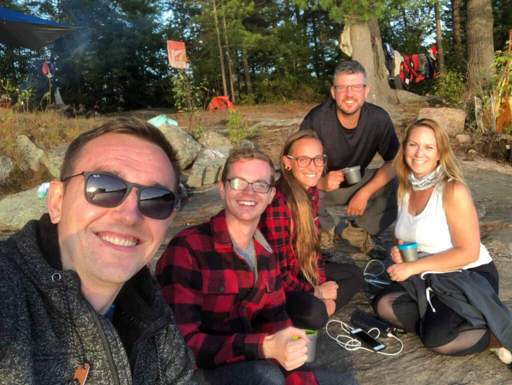 Travel writers on portage, back country canoe portage and camping trip