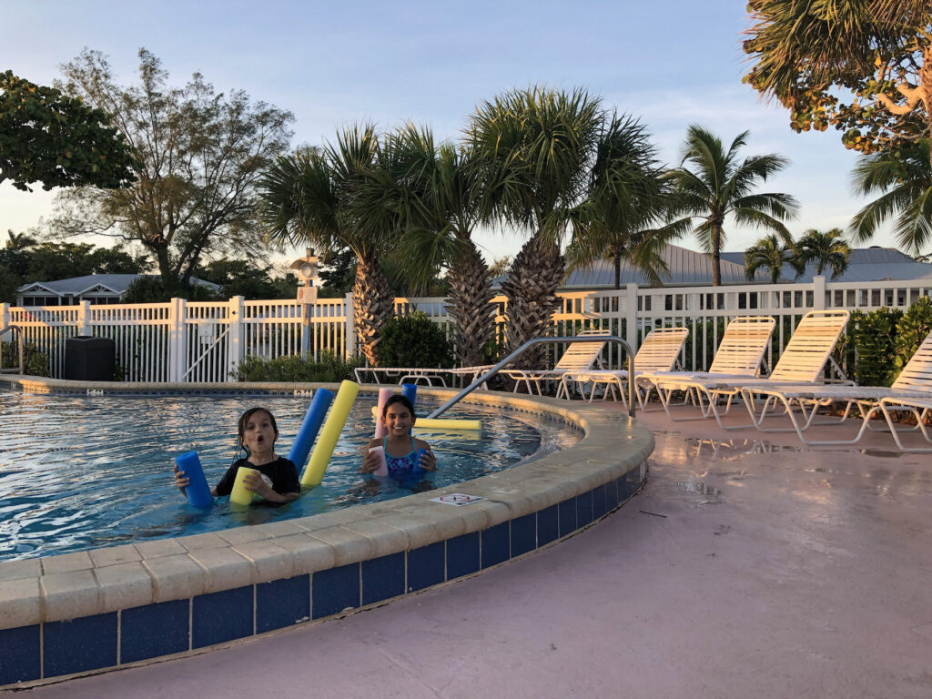 My kids enjoying fun with pool noodles in the pool of Island Inn on Sanibel Island