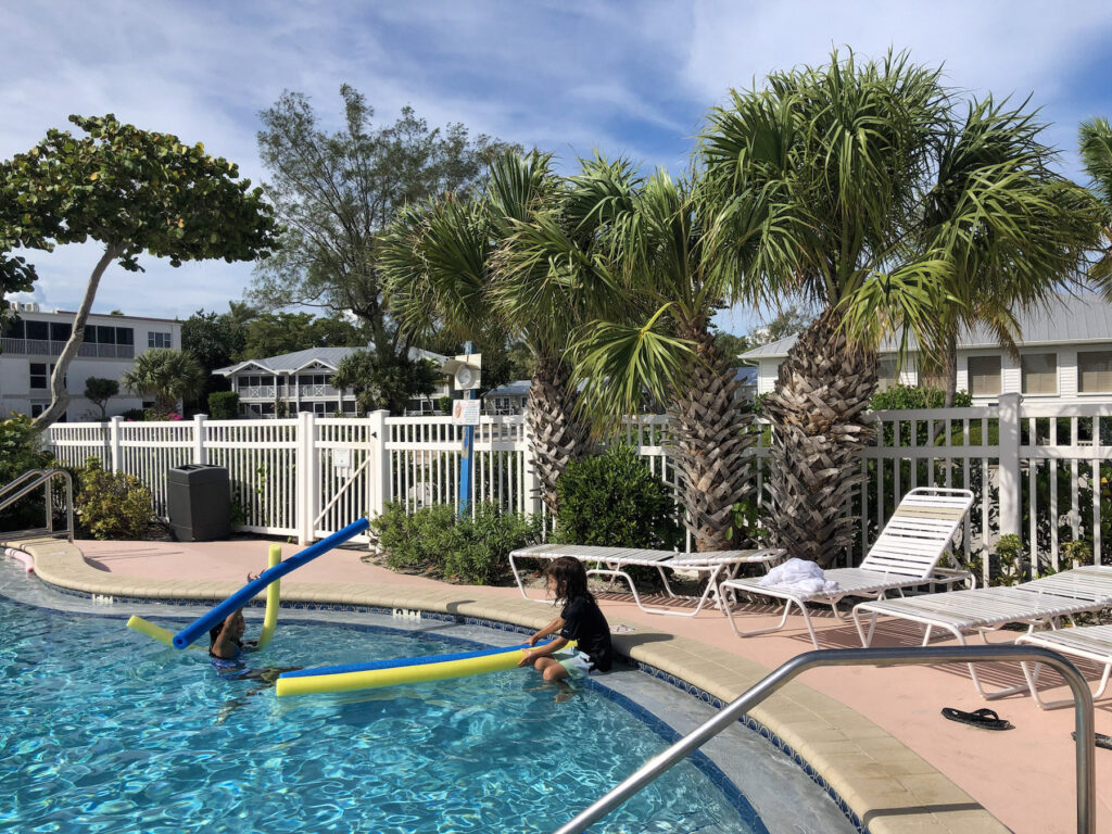 My kids enjoying fun with pool noodles in the pool of Island Inn on Sanibel Island 2
