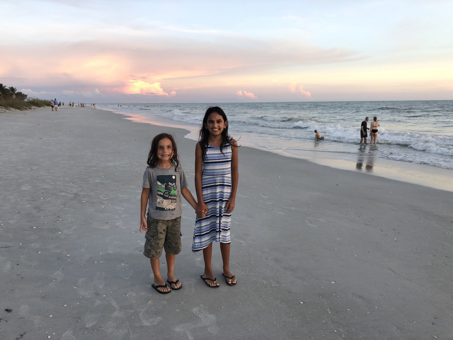 My kids on Sanibel Island at sunset. Visiting Sanibel Island With Kids? You'll want to read this!