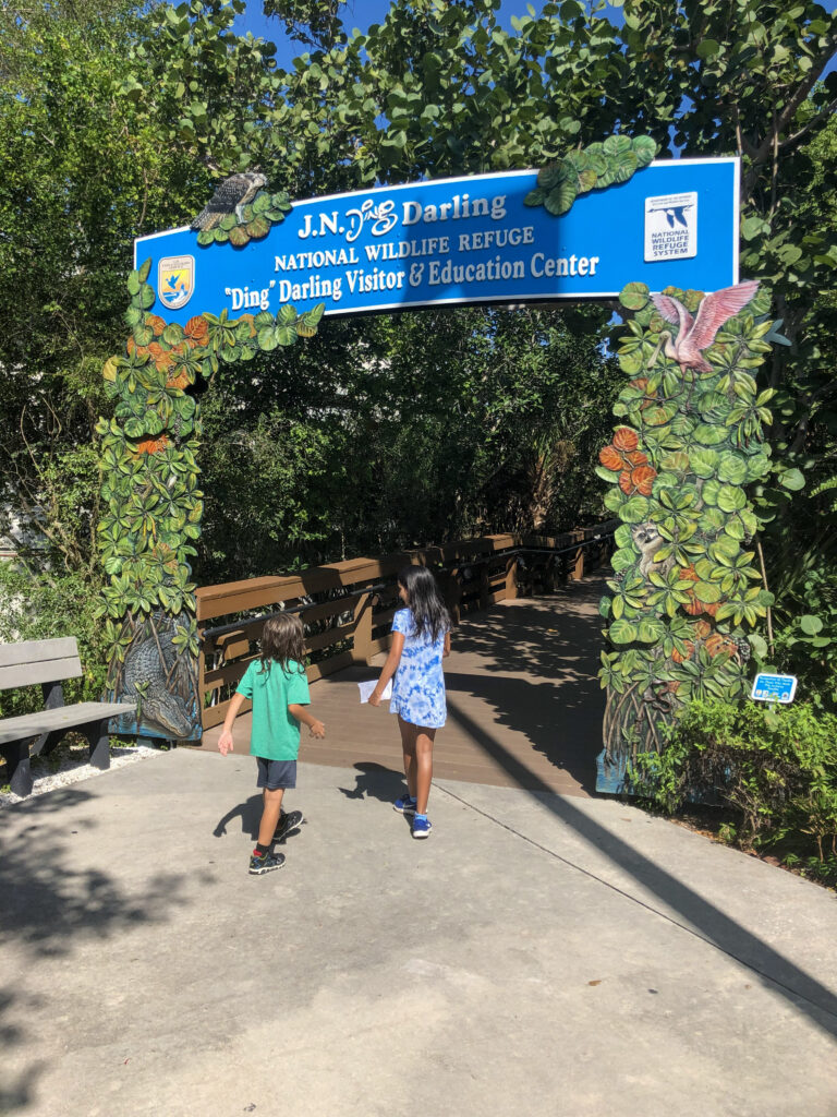 My kids walking up to J.N. Ding Darling National Wildlife Refuge visitor centre entrance on Sanibel Island in Florida