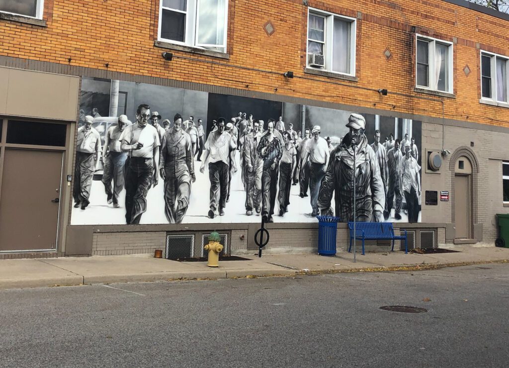 An homage to the autoworkers of Windsor, Ontario in street art. Ford City area of Windsor, Ontario.