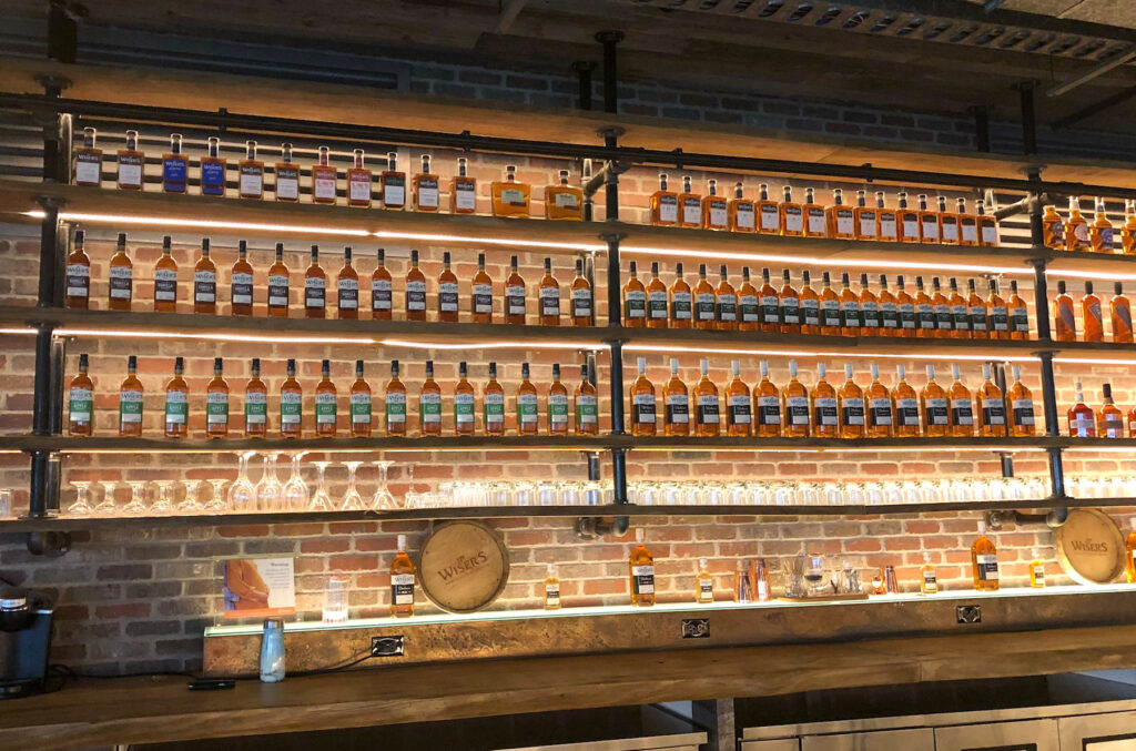 selection of whiskey in J.P. Wiser's distillery bar in the shop