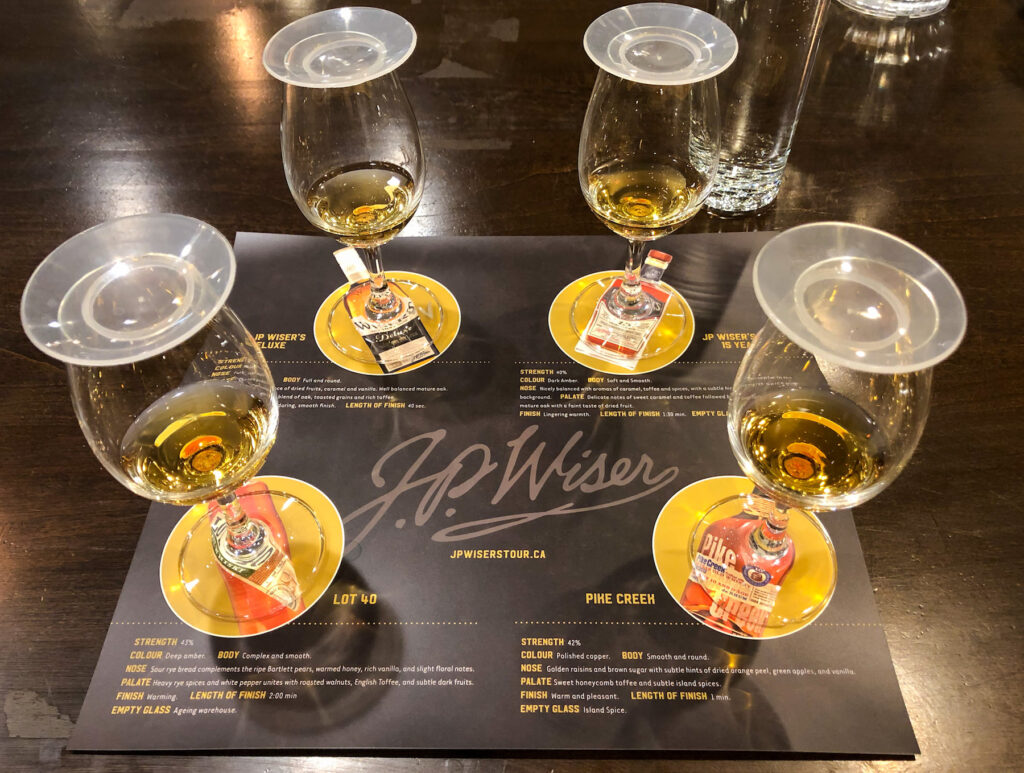 The whiskey tasting selection at J.P. Wiser's distillery experience - we tasted J.P. Wiser's Deluxe, J.P. Wiser's 15 year old, Lot 40 and Pike Creek from Hiram Walker Whisky Tour